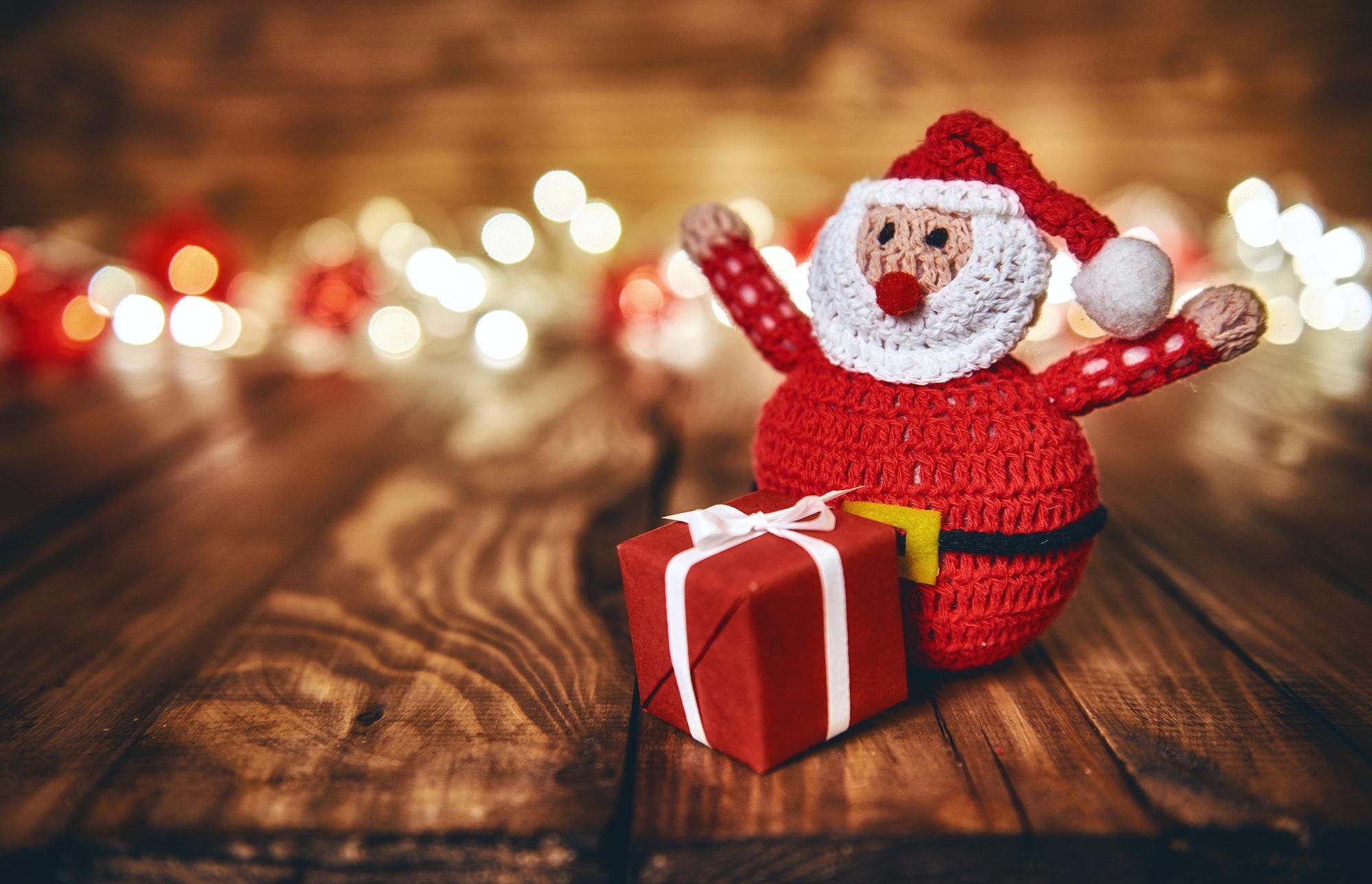 Red gift box, Santa Claus and Christmas garland